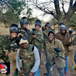 Group photo of smiling paintballers